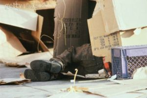 homeless-person-sleeping-in-cardboard-box